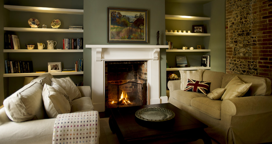 Relax in front of the fire in our cosy sitting room